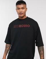 Asos Design ASOS DESIGN Christmas oversized longline t-shirt with hotfix gem Ho Ho Ho text print and stepped hem-Black