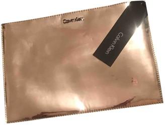 Calvin Klein Gold Metal Clutch bags