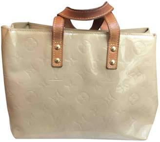 Louis Vuitton Beige Patent leather Handbags