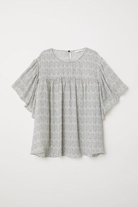H&M Flounce-sleeved blouse