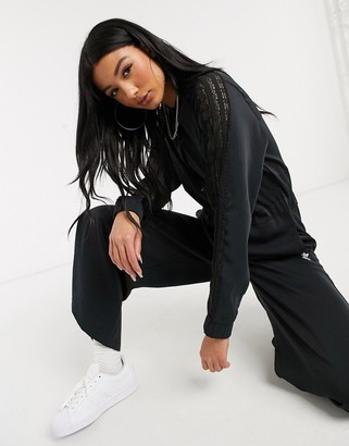 adidas Bellista lace insert jumpsuit in black
