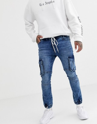 ASOS DESIGN super skinny biker jogger jeans in mid wash blue