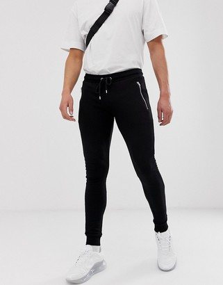 ASOS DESIGN super skinny sweatpants with zips in black
