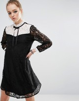 Reclaimed Vintage Mini Dress In Lace With Contrast Bib & Tie Neck