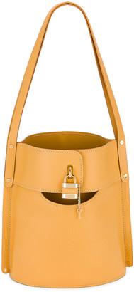 Chloé Aby Embossed Monogram Bucket Bag in Honey Gold   FWRD