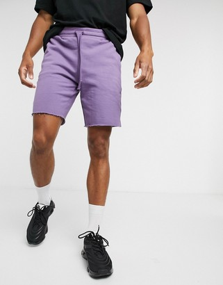 ASOS DESIGN jersey slim shorts with raw hem and flat drawcords in purple