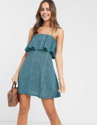 ASOS DESIGN ditsy print sundress with tie back detail in blue