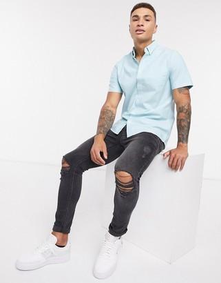 Burton Menswear short sleeve palm print oxford shirt in turquoise