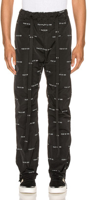Fear Of God All Over Print Baggy Nylon Pant in Black | FWRD