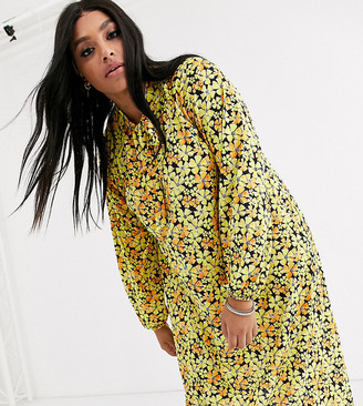 Asos DESIGN Curve long sleeve tie front midi dress in yellow floral
