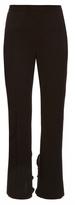 Toga Ruffle-trimmed slim-leg trousers