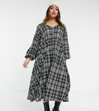 ASOS DESIGN Curve textured midi v-neck swing dress in black and white plaid