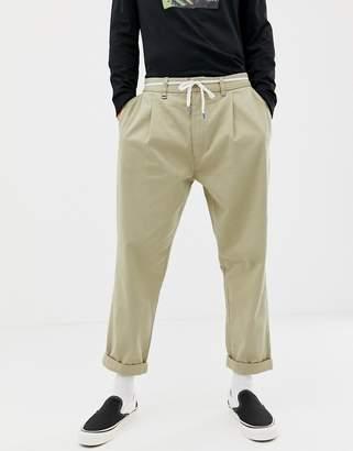 Bershka loose fit trousers in stone