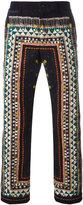 Sacai tribal lace print corduroy trousers