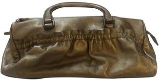 Miu Miu Gold Leather Handbags