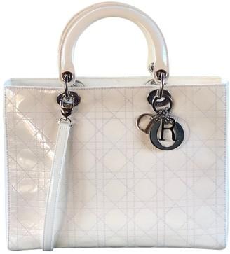 Christian Dior Ecru Patent leather Handbags