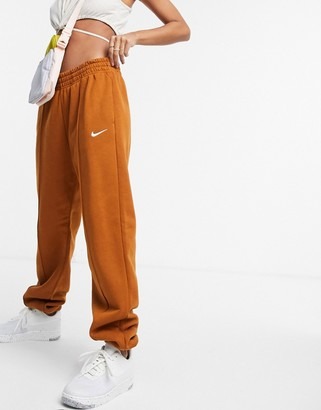 Nike mini swoosh oversized joggers in tawny brown