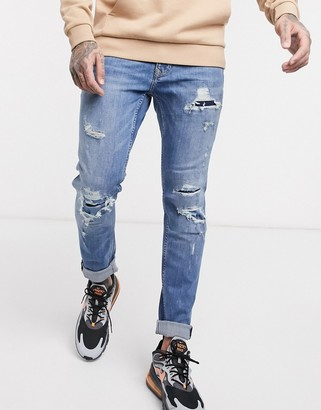 Topman organic skinny jeans with extreme rips in light blue