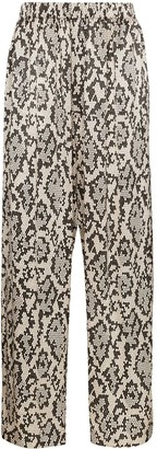 Edward Crutchley snake print trousers