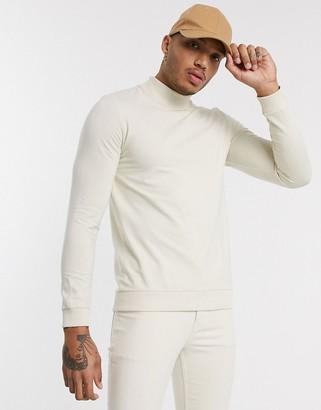 ASOS DESIGN muscle sweatshirt with turtle neck in beige