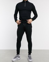 Asos Design DESIGN muscle tracksuit with half zip sweatshirt in black
