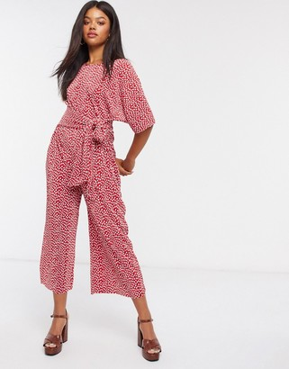 ASOS DESIGN jersey kimono sleeve plisse jumpsuit with tie waist in red spot