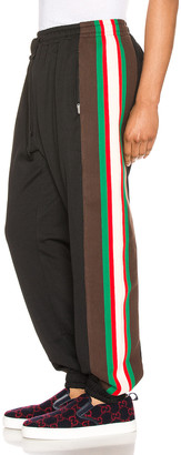 Gucci Track Pants in Black & Green & Red | FWRD