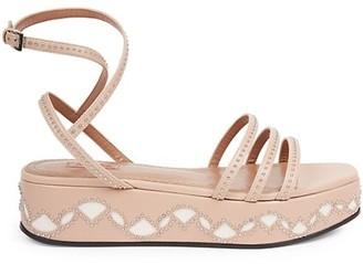 Alaia Studded Leather Flatform Sandals