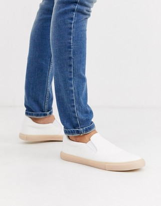 ASOS DESIGN slip on plimsolls in white leather look with gum sole