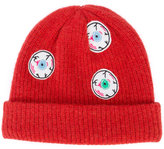 The Elder Statesman eyes beanie