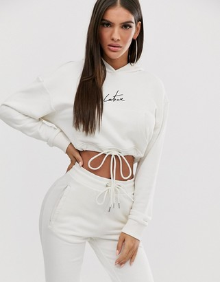 Couture The Club cropped motif drawstring hoody in cream