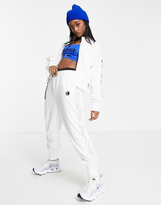 Nike Sisterhood lace up detail polyknit track pants in white