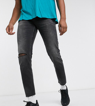 ASOS DESIGN Tall cropped slim jeans in washed black with raw hem and knee rip