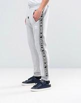 Adidas Originals Taping Joggers In Grey Ay8268