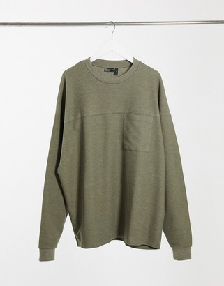 ASOS DESIGN oversized long-sleeved waffle T-shirt with pocket and seam detail in khaki