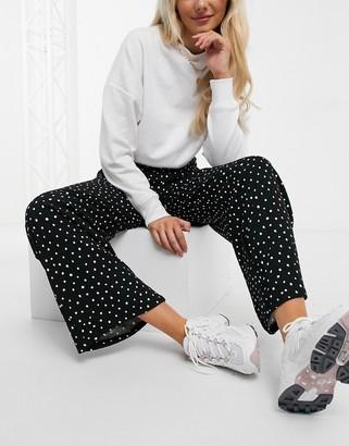 Monki Sissela spot print wide leg jersey trousers in black