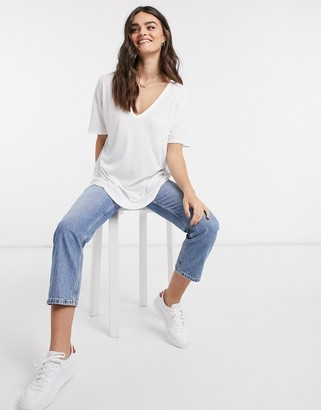 ASOS DESIGN oversized v neck top with curved hem in clean rib in white