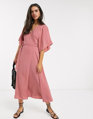 Liquorish wrap front midi dress in dusty pink