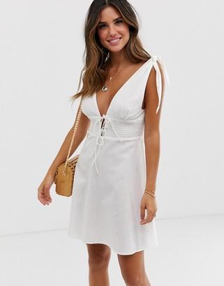 Asos Design DESIGN tie shoulder plunge mini sundress with shirred waist