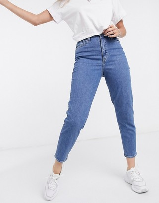 Levi's high waisted tapered jeans in washed blue