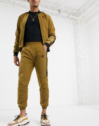 SikSilk nylon sweatpants in gold with logo side stripe