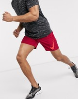 Nike Running Challenger shorts in red