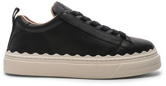 Chloé Low Top Sneakers in Black | FWRD