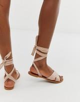 tie leg flat sandal