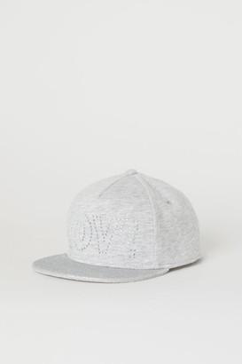 H&M Cap with a text motif