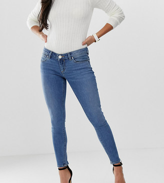 Asos DESIGN Petite Whitby low rise skinny jeans in mid wash blue