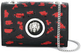Versus lion stud clutch