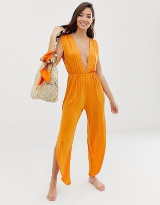 Asos DESIGN slinky jersey plunge beach jumpsuit with splits in burnt orange