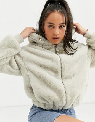 Bershka faux fur zip up coat with hood in light grey