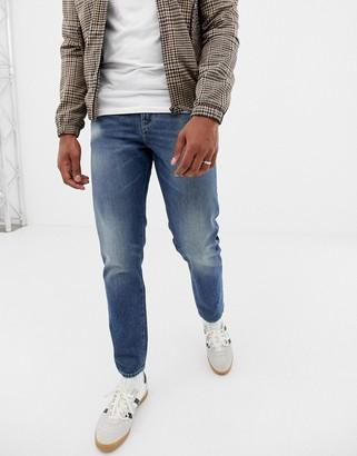 ASOS DESIGN 12.5oz slim jeans in vintage mid wash with abrasions